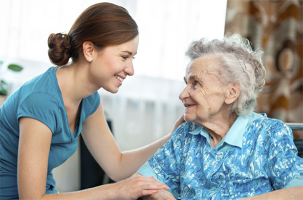 Carer and elderly woman